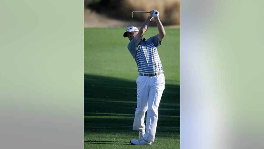 Ryan Palmer hits form the fairway on the eighth hole during the second round of the Humana Challenge golf tournament on Friday, Jan. 23, 2015, in La Quinta, Calif. (AP Photo/Chris Carlson)