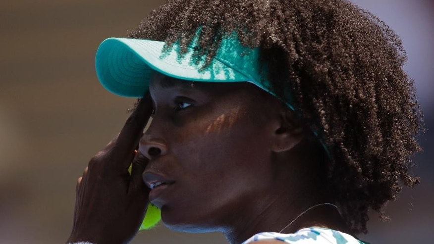 Venus Williams of the U.S. reacts as she plays Camila Giorgi of Italy during their third round match at the Australian Open tennis championship in Melbourne, Australia, Saturday, Jan. 24, 2015. (AP Photo/Bernat Armangue)