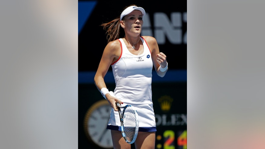 Agnieszka Radwanska of Poland celebrates after defeating Varvara Lepchenko of the U.S. during their third round match at the Australian Open tennis championship in Melbourne, Australia, Saturday, Jan. 24, 2015. (AP Photo/Lee Jin-man)