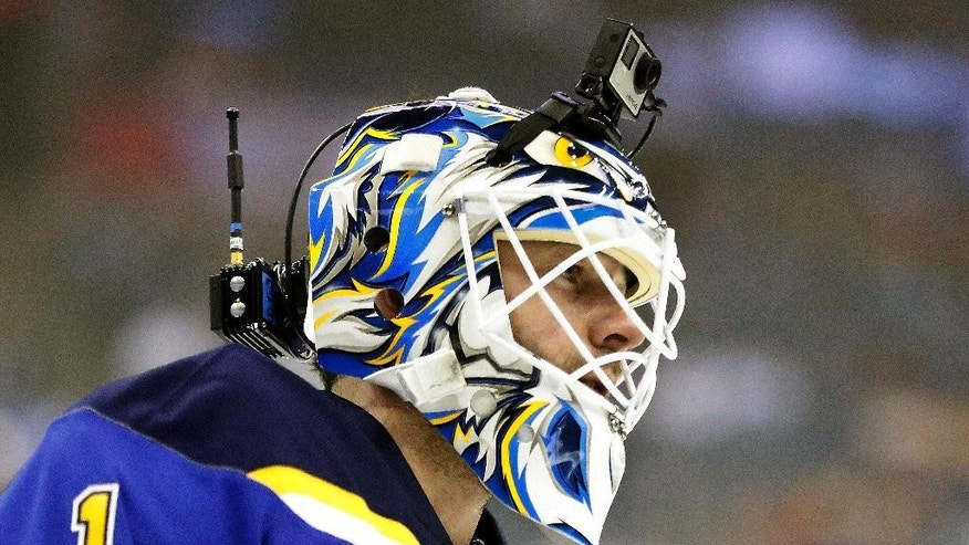 St. Louis Blues goalie Brian Elliot, a member of Team Foligno, wears a remote camera on his mask during warm ups before the NHL All-Star hockey skills competition in Columbus, Ohio, Saturday, Jan. 24, 2015. (AP Photo/Gene J. Puskar)