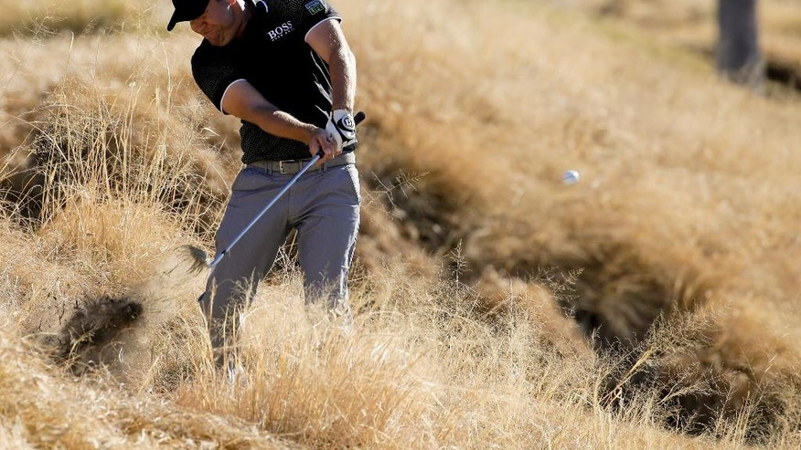 Erik Compton hits from the tall grass on the first hole during the third round of the Humana Challenge golf tournament on the Nicklaus Private course at PGA West, Saturday, Jan. 24, 2015, in La Quinta, Calif. (AP Photo/Chris Carlson)