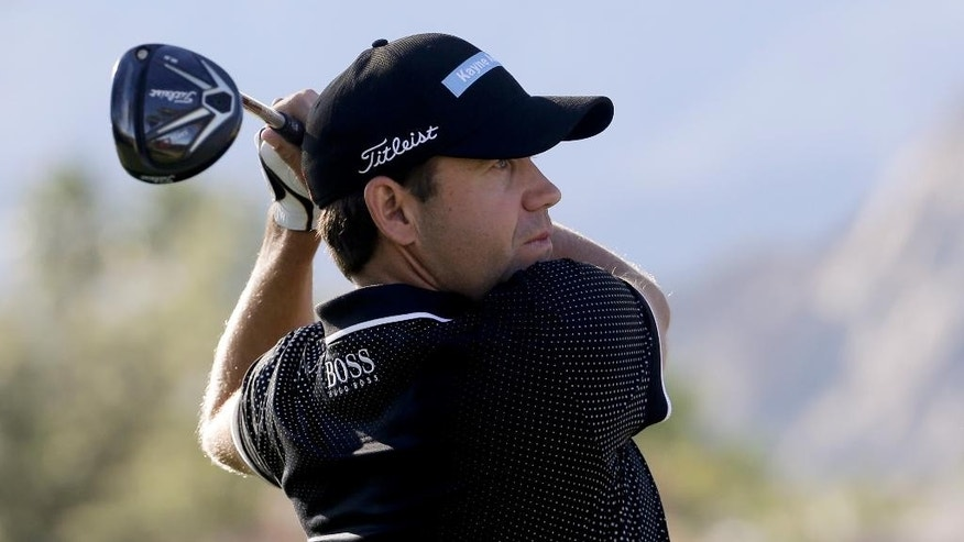 Erik Compton watches his tee shot on the first hole during the third round of the Humana Challenge golf tournament on the Nicklaus Private course at PGA West on Saturday, Jan. 24, 2015 in La Quinta, Calif. (AP Photo/Chris Carlson)