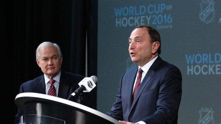 NHL Commissioner Gary Bettman, right, and NHL Player's Association Executive Director Donald Fehr take part in announcing the return of the World Cup of Hockey in 2016 in Toronto, during a news conference at Nationwide Arena in Columbus, Ohio, before the NHL All-Star hockey skills competition, Saturday, Jan. 24, 2015. (AP Photo/Gene J. Puskar)