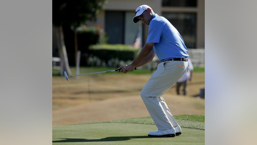 Bill Haas reacts after missing a birdie on the second hole during the final round of the Humana Challenge golf tournament on the Palmer Private course at PGA West on Sunday, Jan. 25, 2015, in La Quinta, Calif. (AP Photo/Chris Carlson)