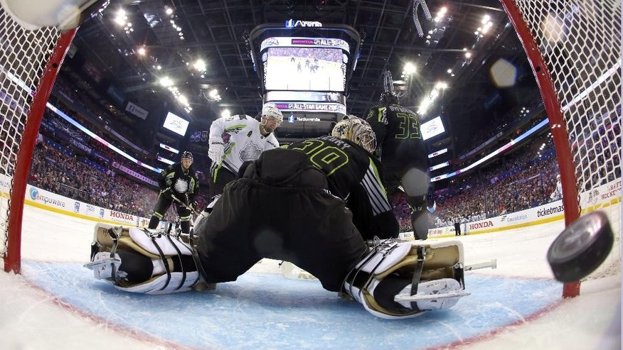 Team Foligno goalie Marc-Andre Fleury of the Pittsburgh Penguins can't stop a shot by Team Toews' Rick Nash (61) of the New York Rangers during the second period of the NHL All-Star hockey game in Columbus, Ohio, Sunday, Jan. 25, 2015.(AP Photo/Bruce Bennett)