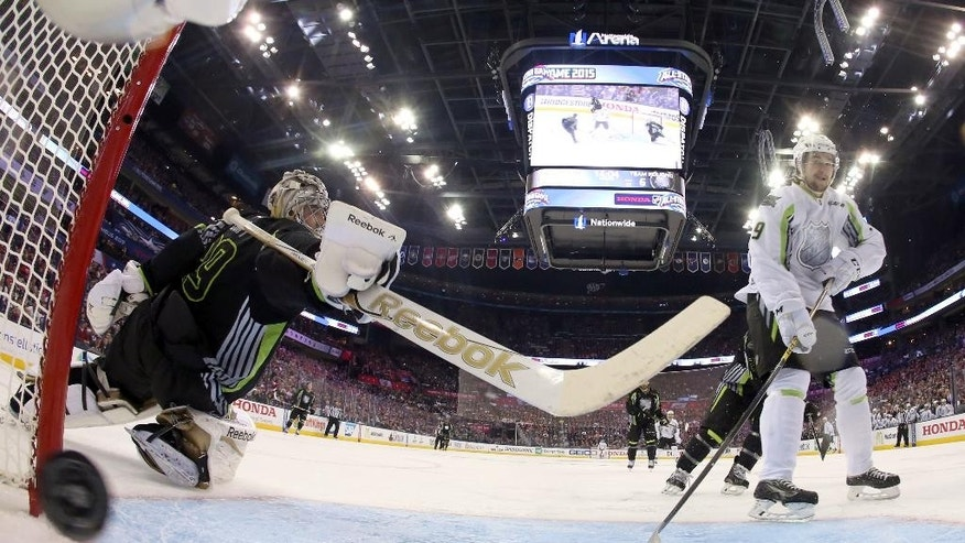 Team Foligno goalie Marc-Andre Fleury of the Pittsburgh Penguins can't stop a shot by Team Toews' Filip Forsberg (9) of the Nashville Predators during the second period of the NHL All-Star hockey game in Columbus, Ohio, Sunday, Jan. 25, 2015.(AP Photo/Bruce Bennett)