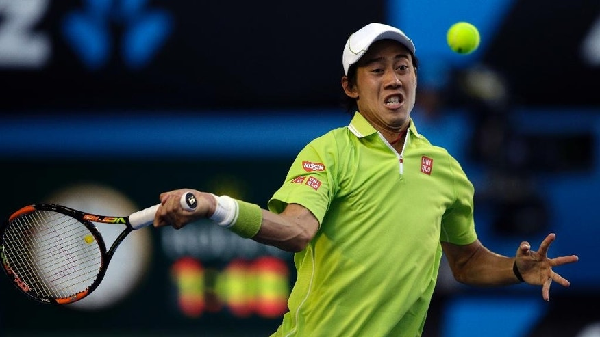 Kei Nishikori of Japan makes a forehand return to David Ferrer of Spain during their fourth round match at the Australian Open tennis championship in Melbourne, Australia, Monday, Jan. 26, 2015. (AP Photo/Lee Jin-man)