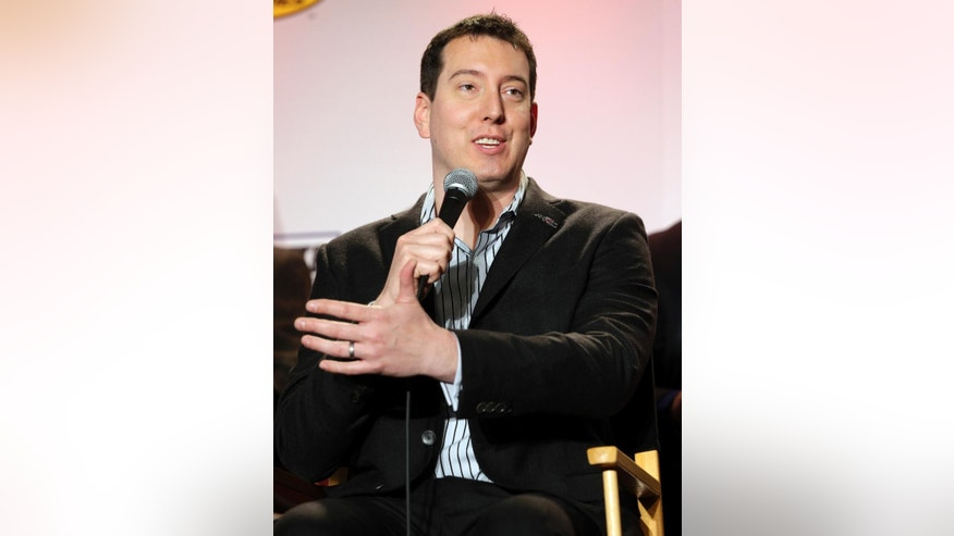 Driver Kyle Busch speaks to the media during the NASCAR Charlotte Motor Speedway Media Tour in Charlotte, N.C., Monday, Jan. 26, 2015. (AP Photo/Chuck Burton)