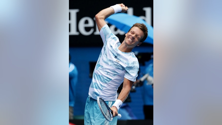 Tomas Berdych of the Czech Republic celebrates after defeating Rafael Nadal of Spain in their quarterfinal match at the Australian Open tennis championship in Melbourne, Australia, Tuesday, Jan. 27, 2015. (AP Photo/Rob Griffith)