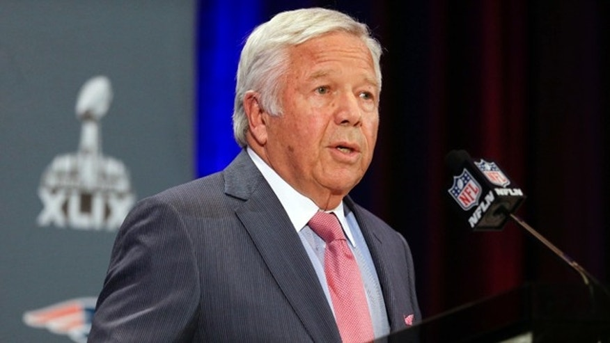 Jan. 26, 2015: New England Patriots owner Robert Kraft reads a statement during a news conference in Chandler, Ariz. (AP Photo/Mark Humphrey)