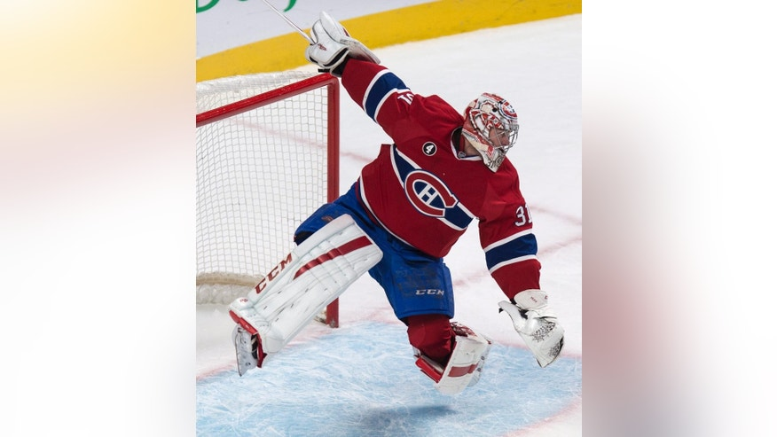 Montreal Canadiens goalie Carey Price loses his balance after making a save against the Dallas Stars during the second period of an NHL hockey game Tuesday, Jan. 27, 2015, in Montreal. (AP Photo/The Canadian Press, Paul Chiasson)