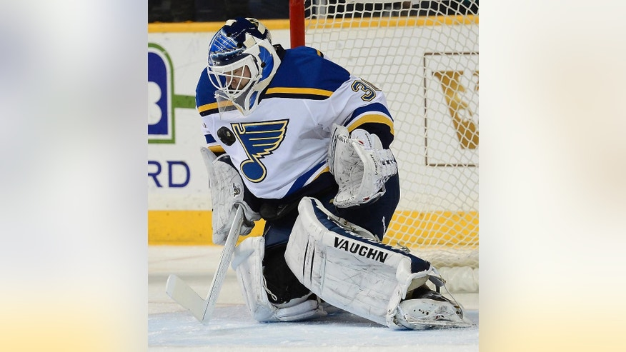 FILE - In this Dec. 4, 2014, file photo, St. Louis Blues goalie Martin Brodeur blocks a shot during the first period of an NHL hockey game against the Nashville Predators in Nashville, Tenn. Brodeur, one of the greatest goaltenders in NHL history, is retiring. He starred for years with New Jersey Devils and is now with St. Louis. (AP Photo/Mark Zaleski, File(