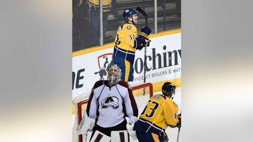 Nashville Predators center Colin Wilson (33) celebrates after scoring a goal against Colorado Avalanche goalie Semyon Varlamov (1), of Russia, during the second period of an NHL hockey game Tuesday, Jan. 27, 2015, in Nashville, Tenn. (AP Photo/Mark Zaleski)
