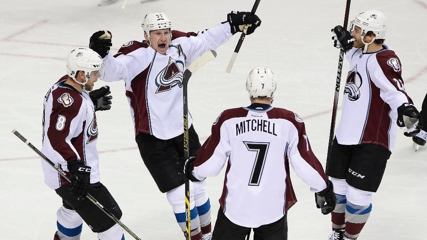 Colorado Avalanche left wing Cody McLeod, second from left, celebrates with Jan Hejda (8), of Czech Republic; John Mitchell (7); and Zach Redmond, right, after scoring a goal during the first period of an NHL hockey game against the Nashville Predators on Tuesday, Jan. 27, 2015, in Nashville, Tenn. (AP Photo/Mark Zaleski)