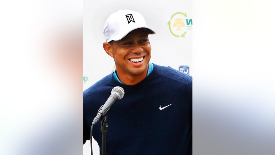 Tiger Woods talks to the media after playing a practice round at the Phoenix Open golf tournament on Tuesday, Jan. 27, 2015, in Scottsdale, Ariz. (AP Photo/Rick Scuteri)