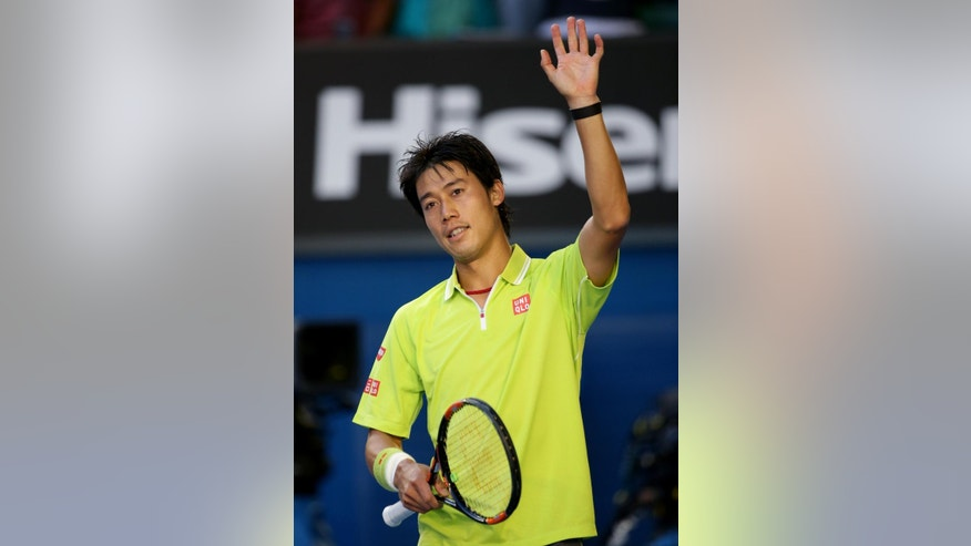 Kei Nishikori of Japan celebrates after winning over David Ferrer of Spain in their fourth round match at the Australian Open tennis championship in Melbourne, Australia, Monday, Jan. 26, 2015. (AP Photo/Rob Griffith)