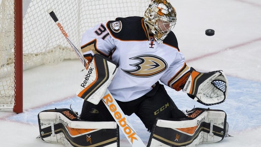 Anaheim Ducks goalie Frederik Andersen, of Denmark, watches as a Vancouver Canucks shot goes wide of the net during the third period of an NHL hockey game Tuesday, Jan. 27, 2015, in Vancouver, British Columbia. (AP Photo/The Canadian Press, Darryl Dyck)