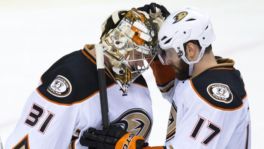 Anaheim Ducks goalie Frederik Andersen, left, of Denmark, is congratulated by Ryan Kesler after earning a shutout during the team's 4-0 win over the Vancouver Canucks in an NHL hockey game in Vancouver, British Columbia, on Tuesday, Jan. 27, 2015. (AP Photo/The Canadian Press, Darryl Dyck)