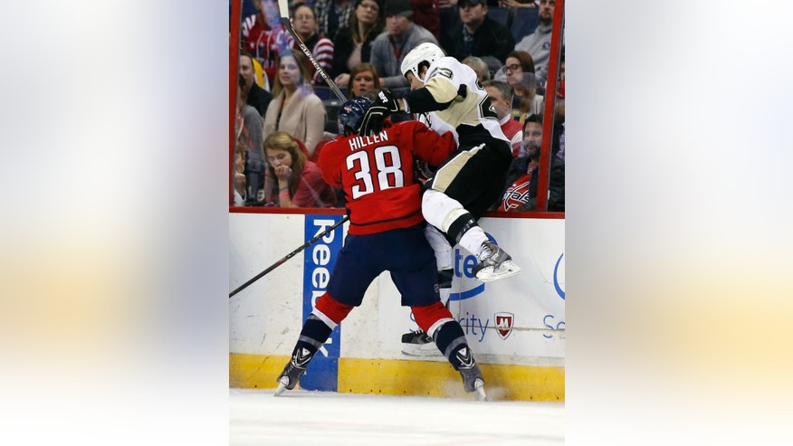 Washington Capitals defenseman Jack Hillen (38) boards Pittsburgh Penguins right wing Steve Downie (23) in the first period of an NHL hockey game, Wednesday, Jan. 28, 2015, in Washington. (AP Photo/Alex Brandon)