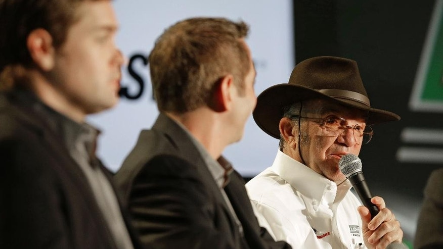 Team owner Jack Roush, right, speaks to the media as drivers Greg Biffle, center, and Ricky Stenhouse Jr, left, listen during the NASCAR Charlotte Motor Speedway media tour in Charlotte, N.C., Wednesday, Jan. 28, 2015. (AP Photo/Chuck Burton)
