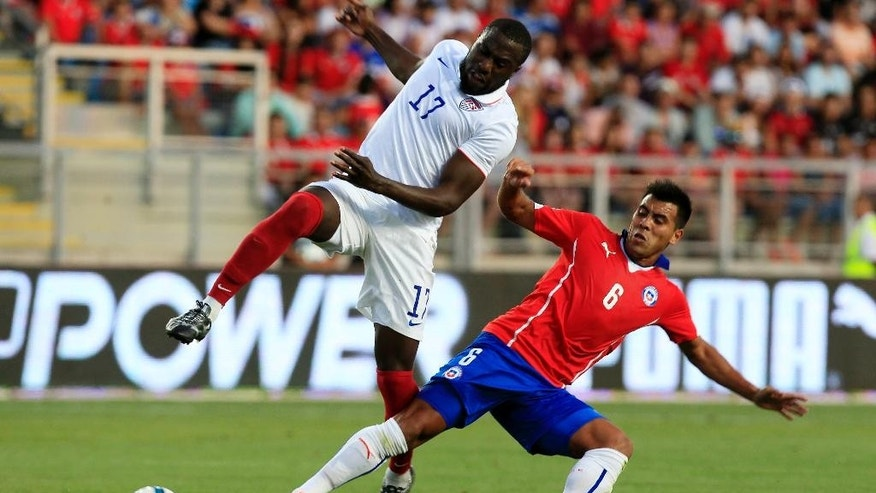 U.S. player Jozy Altidore, left, fights for the ball with Chile's Gonzalo Espinoza during their friendly soccer match in Rancagua, Chile, Wednesday, Jan. 28, 2015. (AP Photo/Luis Hidalgo)