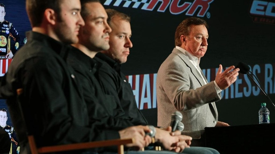 Team owner Richard Childress, right, speaks to the media  as drivers, from left, Austin Dillon, Paul Menard, and Ryan Newman listen during the NASCAR Charlotte Motor Speedway media tour in Charlotte, N.C., Thursday, Jan. 29, 2015. (AP Photo/Chuck Burton)