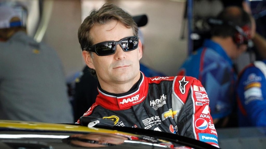 FILE - In this Oct. 10, 2014, file photo, Jeff Gordon climbs into his car before practice for the NASCAR Bank of America Sprint Cup series auto race at Charlotte Motor Speedway in Concord, N.C. Chase Elliott will replace Gordon in the No. 24 Chevrolet when the four-time NASCAR champion gives up his seat at the end of this season. (AP Photo/Terry Renna, File)