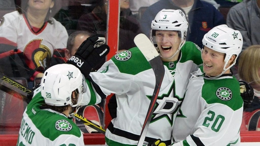 Dallas Stars' John Klingberg celebrates his game winning goal against the Ottawa Senators with teammates David Schlemko, left, and Cody Eakin during the third period on an NHL hockey game, Thursday, Jan. 29, 2015 in Ottawa, Ontario. (AP Photo/Canadian Press, Sean Kilpatrick)