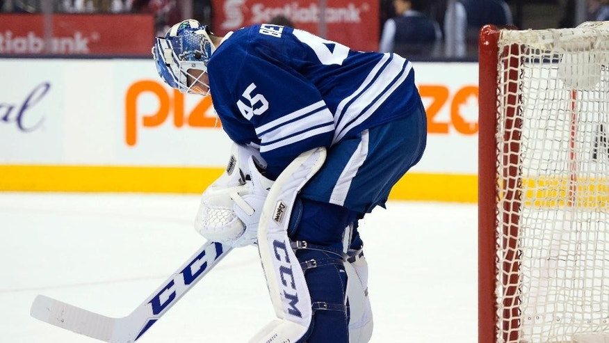 Toronto Maple Leafs goaltender Jonathan Bernier hangs his head during the third period of an NHL hockey game against the Arizona Coyotes on Thursday, Jan. 29, 2015, in Toronto. (AP Photo/The Canadian Press, Frank Gunn)