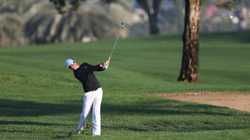 Rory McIlroy of Northern Ireland plays a shot on the 10th hole during the round one of the Dubai Desert Classic golf tournament in Dubai, United Arab Emirates, Thursday, Jan. 29, 2015. (AP Photo/Kamran Jebreili)