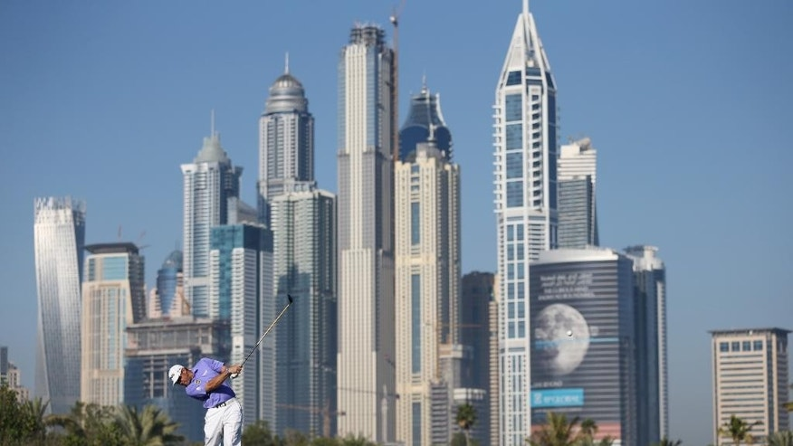Lee Westwood of England plays a ball on the 13th hole during the round one of the Dubai Desert Classic golf tournament in Dubai, United Arab Emirates, Thursday, Jan. 29, 2015. (AP Photo/Kamran Jebreili)