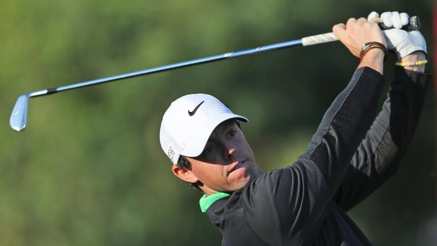 Rory McIlroy of Northern Ireland tees off on the 11th hole during the round one of the Dubai Desert Classic golf tournament in Dubai, United Arab Emirates, Thursday, Jan. 29, 2015. (AP Photo/Kamran Jebreili)