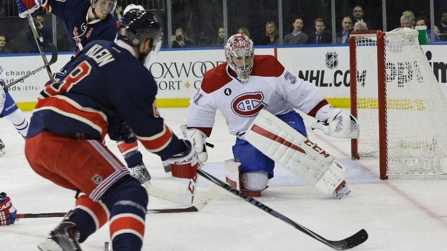 Montreal Canadiens goalie Carey Price (31) defends the net against a shot at goal by New York Rangers defenseman Kevin Klein (8) during the second period of the NHL hockey game Thursday, Jan. 29, 2015 at Madison Square Garden in New York.  (AP Photo/Mary Altaffer)