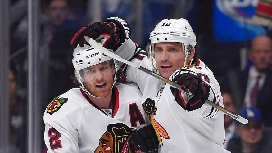 Chicago Blackhawks left wing Patrick Sharp, right, celebrates his goal with defenseman Duncan Keith during the first period of an NHL hockey game against the Los Angeles Kings, Wednesday, Jan. 28, 2015, in Los Angeles. (AP Photo/Mark J. Terrill)
