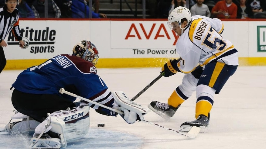 Colorado Avalanche goalie Semyon Varlamov, left, of Russia, stops a breakaway shot off the stick of Nashville Predators left wing Gabriel Bourque in the second period of an NHL hockey game Friday, Jan. 30, 2015, in Denver. (AP Photo/David Zalubowski)