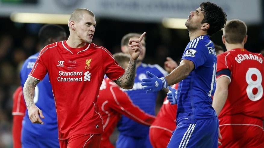 Liverpool's Martin Skrtel, left, gestures toward Chelsea's Diego Costa during the English League Cup semifinal second leg soccer match between Chelsea and Liverpool at Stamford Bridge stadium in London, Tuesday, Jan. 27, 2015. (AP Photo/Alastair Grant)