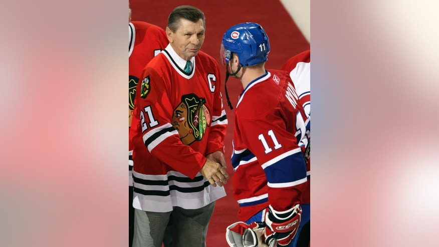 "FILE - In this Jan. 8, 2008, file photo, Montreal Canadiens captain Saku Koivu (11) talks with Chicago Blackhawks great Stan Mikita during a pregame ceremony in Montreal. Mikita's family says the Blackhawks Hall of Famer has been diagnosed with a suspected brain disorder, adding that the 74-year-old is ""facing some serious health issues"" and has suspected Lewy body dementia. (AP Photo/The Canadian Press, Paul Chiasson, File)"