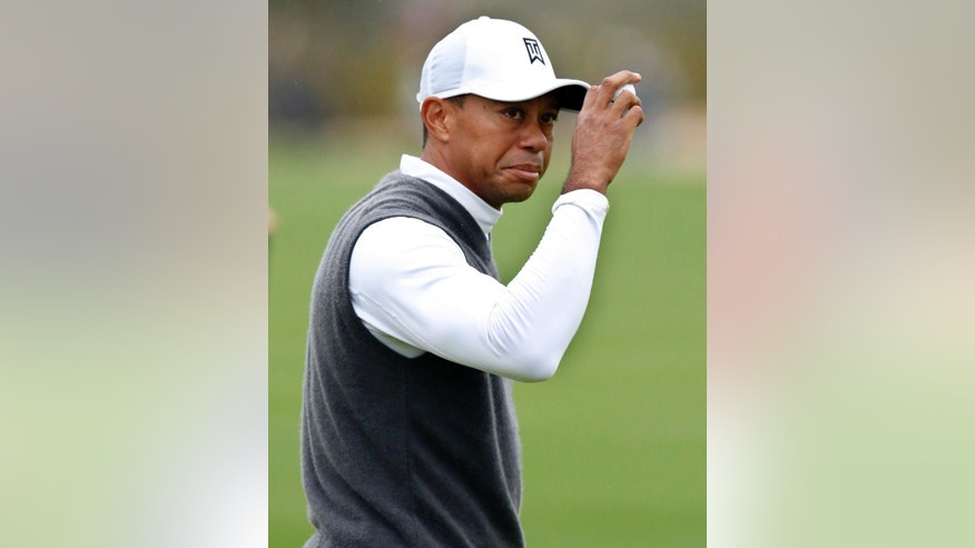 Tiger Woods acknowledges the gallery on the ninth hole during the second round of the Phoenix Open golf tournament, Friday, Jan. 30, 2015, in Scottsdale, Ariz. (AP Photo/Rick Scuteri)
