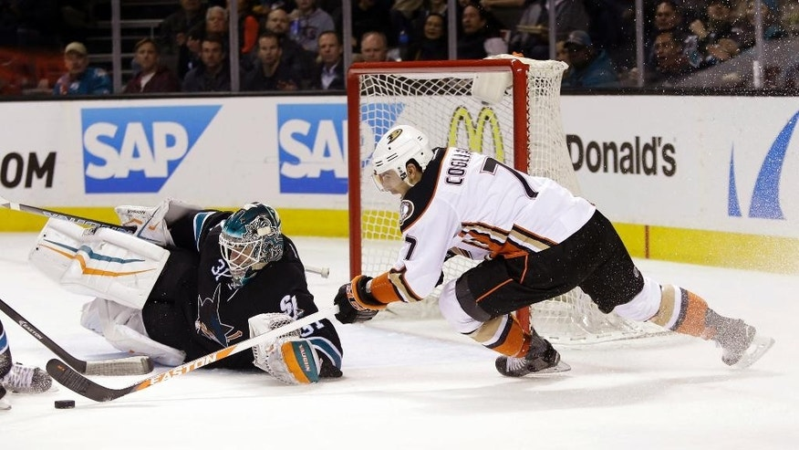 San Jose Sharks goalie Antti Niemi, left, blocks a shot by Anaheim Ducks' Andrew Cogliano (7) during the second period of an NHL hockey game Thursday, Jan. 29, 2015, in San Jose, Calif. (AP Photo/Marcio Jose Sanchez)