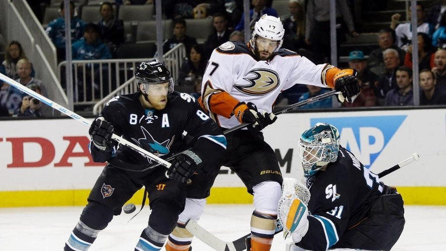 Anaheim Ducks' Ryan Kesler (17) is tangled between San Jose Sharks' Joe Pavelski, left, and goalie Antti Niemi during the second period of an NHL hockey game Thursday, Jan. 29, 2015, in San Jose, Calif. (AP Photo/Marcio Jose Sanchez)