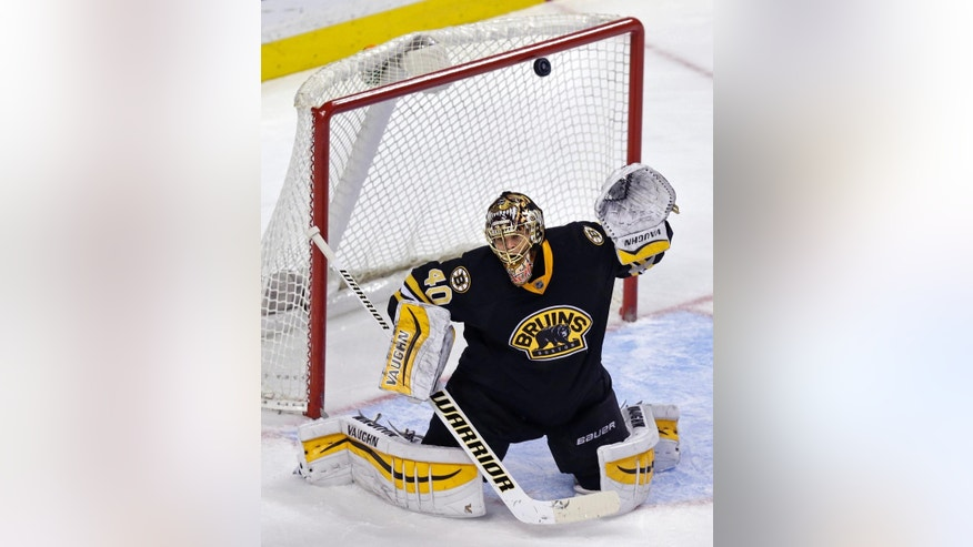 Boston Bruins goalie Tuukka Rask (40) drops to his pads but can't make the save on a goal by Los Angeles Kings center Jordan Nolan during the third period of an NHL hockey game, Saturday, Jan. 31, 2015, in Boston. (AP Photo/Charles Krupa)