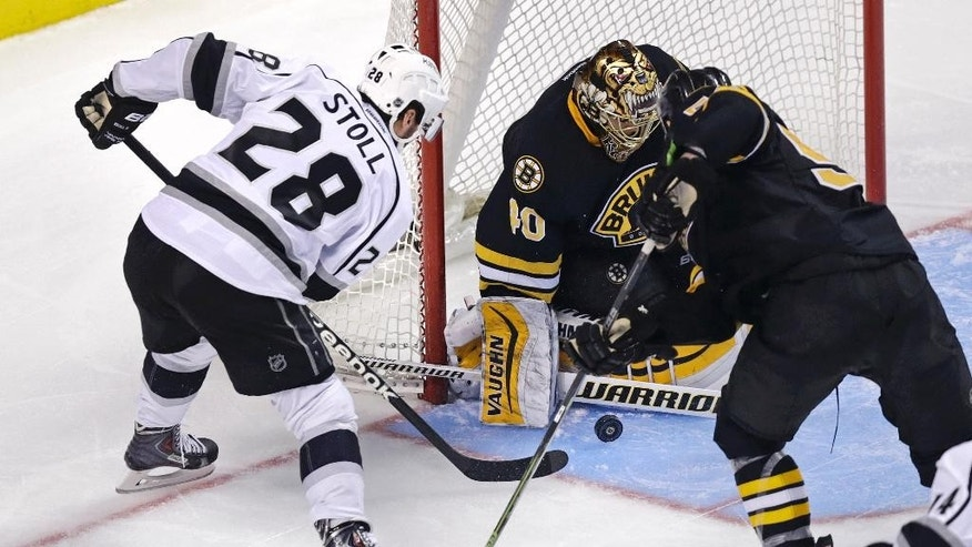 Boston Bruins goalie Tuukka Rask (40) makes a save on a shot by Los Angeles Kings center Jarret Stoll (28) during the third period of an NHL hockey game, Saturday, Jan. 31, 2015, in Boston. (AP Photo/Charles Krupa)