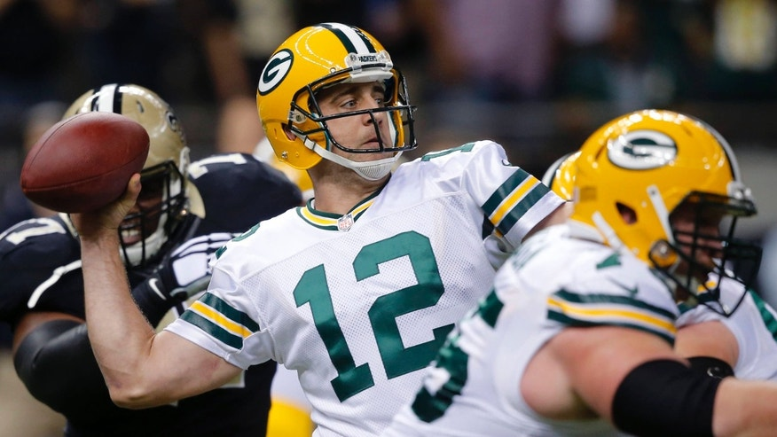 Oct. 26, 2014: Green Bay Packers quarterback Aaron Rodgers throws a touchdown pass during the first half of an NFL football game against the New Orleans Saints in New Orleans.