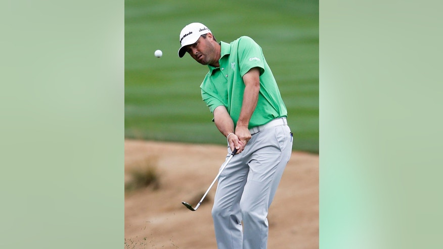 CORRECTS DAY OF WEEK - Ryan Palmer hits out of the rough on fifth hole during the third round of the Phoenix Open golf tournament, Saturday, Jan. 31, 2015, in Scottsdale, Ariz. (AP Photo/Rick Scuteri)