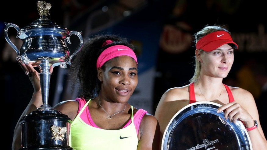 Jan. 31, 2015: Serena Williams of the U.S., left, holds the trophy with runner-up Maria Sharapova of Russia after winning the women's singles final at the Australian Open tennis championship in Melbourne, Australia.