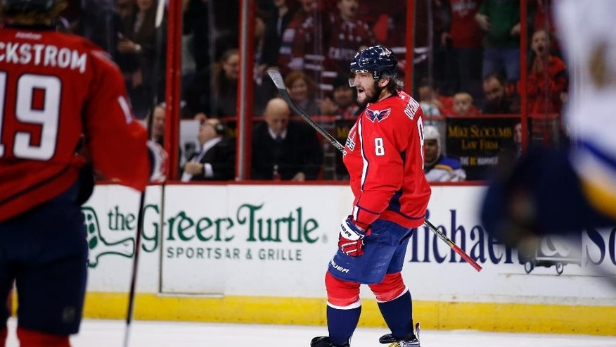 Washington Capitals left wing Alex Ovechkin (8), from Russia, celebrates his goal in the first period of an NHL hockey game against the St. Louis Blues, Sunday, Feb. 1, 2015, in Washington. (AP Photo/Alex Brandon)