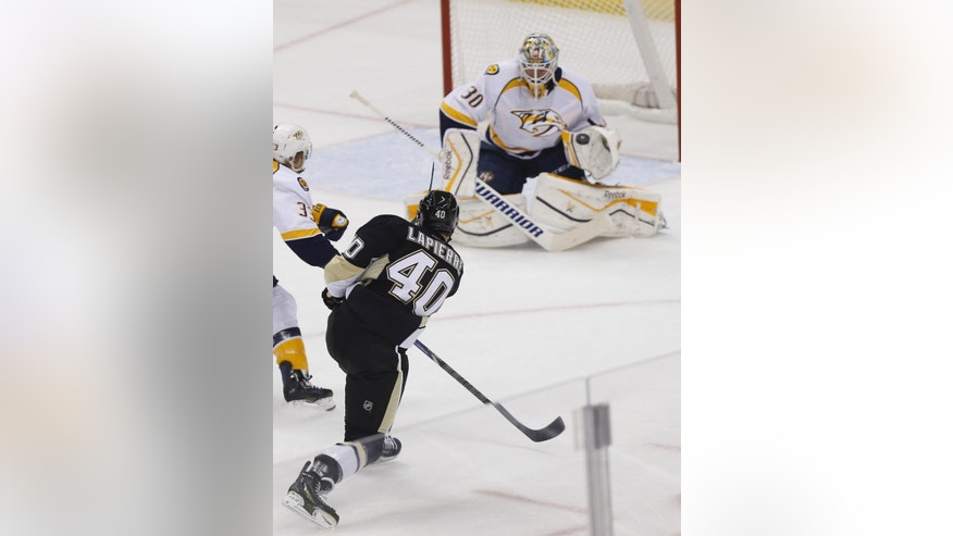 Nashville Predators goalie Carter Hutton (30) makes a save on a shot by Pittsburgh Penguins' Maxim Lapierre (40) in the first period of an NHL hockey game, Sunday, Feb. 1, 2015 in Pittsburgh. (AP Photo/Keith Srakocic)