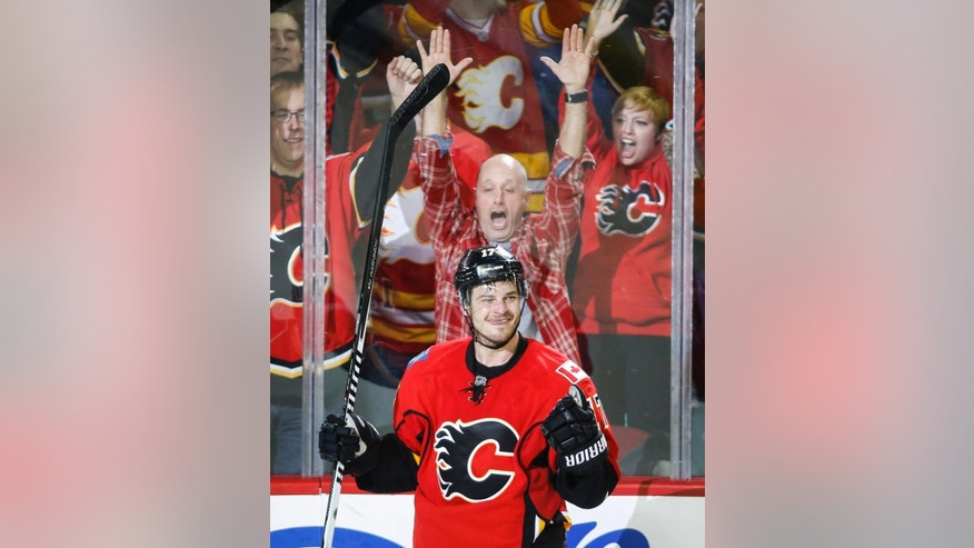 Calgary Flames' Lance Bouma celebrates his goal against the Edmonton Oilers during the third period of an NHL hockey game Saturday, Jan. 31, 2015, in Calgary, Alberta. (AP Photo/The Canadian Press, Jeff McIntosh)
