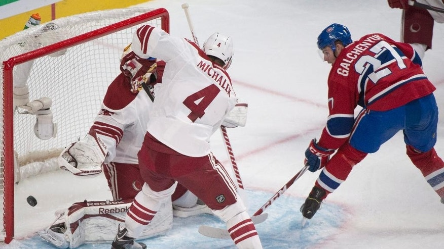 Montreal Canadiens' Alex Galchenyuk, right, scores on Arizona Coyotes goaltender Louis Domingue as Coyotes' Zbynek Michalek (4) defends during first period NHL hockey action in Montreal, Sunday, Feb. 1, 2015. (AP Photo/The Canadian Press, Graham Hughes)