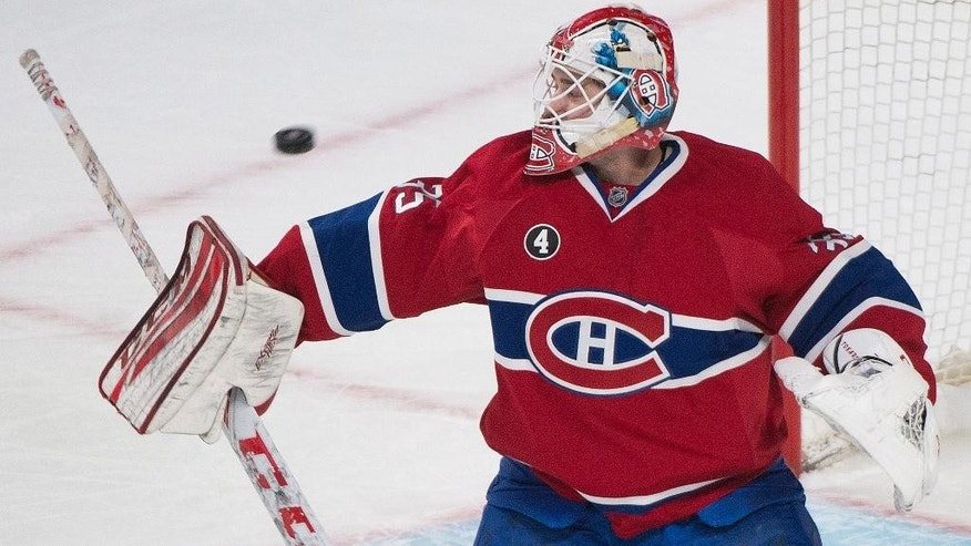Montreal Canadiens Dustin Tokarski makes a save on the Arizona Coyotes during first period NHL hockey action in Montreal, Sunday, Feb. 1, 2015. (AP Photo/The Canadian Press, Graham Hughes)